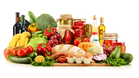 Assorted grocery products including vegetables fruits wine bread dairy and meat isolated on white