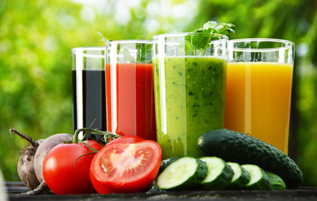 Photo for Glasses with fresh vegetable juices in the garden  Detox diet  - Royalty Free Image