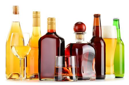 Foto de Bottles and glasses of assorted alcoholic beverages isolated on white background - Imagen libre de derechos