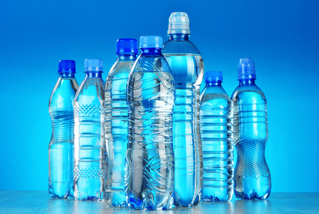 Photo pour Composition with assorted plastic bottles of mineral water - image libre de droit