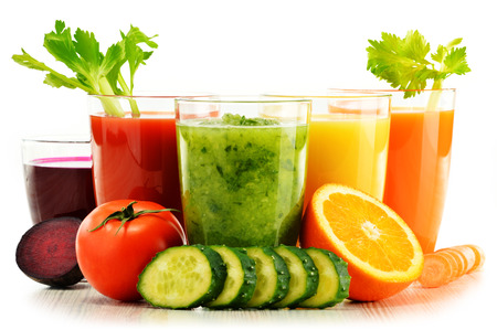 Photo for Glasses with fresh organic vegetable and fruit juices isolated on white. Detox diet. - Royalty Free Image