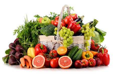 Photo pour Variety of organic vegetables and fruits in wicker basket isolated on white - image libre de droit