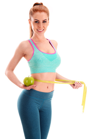 Photo pour Young woman holding measure tape and apple. Weight loss. - image libre de droit