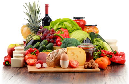 Foto de Variety of organic food including vegetables fruit bread dairy and meat. Balanced diet. - Imagen libre de derechos