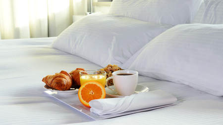 Photo pour Breakfast in bed in hotel room. Accommodation. - image libre de droit