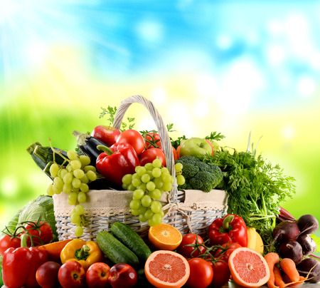 Variety of organic vegetables and fruits in wicker basket