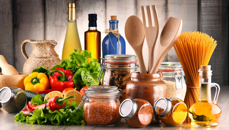Foto de Composition with assorted food products and kitchen utensils on the table - Imagen libre de derechos