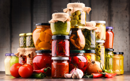 Photo for Jars with variety of pickled vegetables. Preserved food - Royalty Free Image