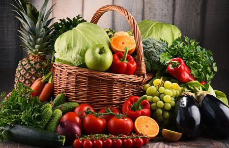 Photo pour Composition with assorted raw organic vegetables and fruits. Detox diet - image libre de droit