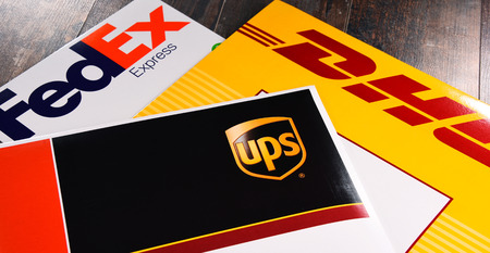 Foto de POZNAN, POL - AUG 2, 2017: Envelopes of 3 most popular courier services in the world: UPS, FedEx and DHL - Imagen libre de derechos