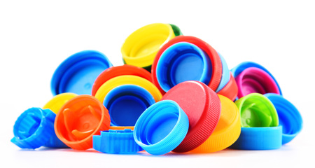Foto de Plastic bottle caps isolated on white background. - Imagen libre de derechos