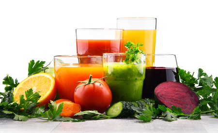Foto de Glasses with fresh organic vegetable and fruit juices. Detox diet - Imagen libre de derechos