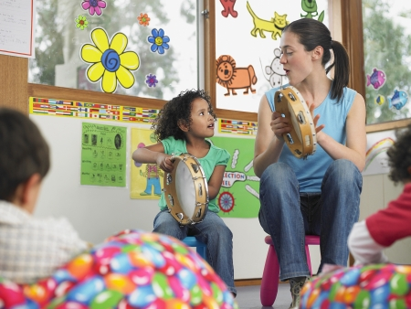 Photo for Teacher Demonstrating Tambourine Playing - Royalty Free Image