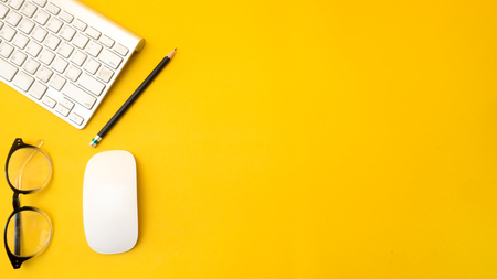 Photo pour Office desk table Top view with keyboard copy space yellow background - image libre de droit
