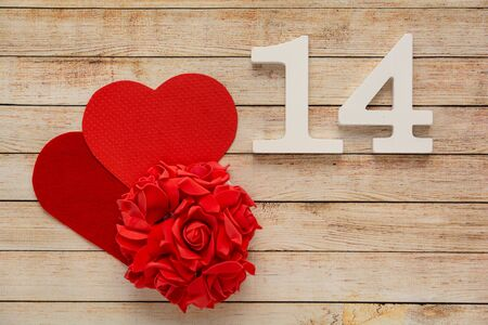 Photo pour Wooden background with flowers, hearts and wooden numbers of dated 14 February. The concept of Valentine Day. - image libre de droit
