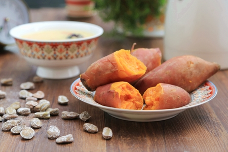 Photo for Sweet potatoes. Cooked whole and halved sweet potatoes - Royalty Free Image