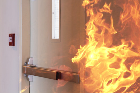 Photo pour Fire burning in front of the closed door. - image libre de droit