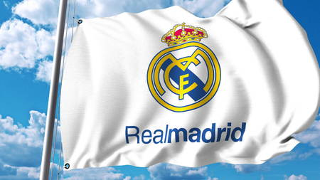 Photo pour Waving flag with Real Madrid football team logo. Editorial 3D rendering - image libre de droit