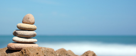 Photo for Pyramid of stones on the shore of the blue sea, harmony, panoramic - Royalty Free Image