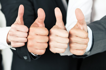Photo for Business team pointing up their thumbs. of different business people pointing up. Concept of success and teamwork. - Royalty Free Image