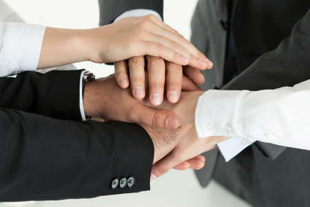 Foto per Closeup of business team showing unity with putting their hands together on top of each other. Concept of teamwork. - Immagine Royalty Free