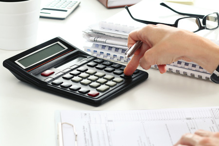 Photo pour Close up of female accountant or banker making calculations. Savings, finances and economy concept - image libre de droit