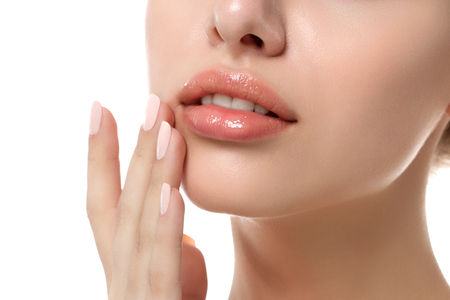 Photo pour Close up view of young beautiful caucasian woman face isolated over white background. Lips contouring, SPA therapy, skincare, cosmetology and plastic surgery concept - image libre de droit