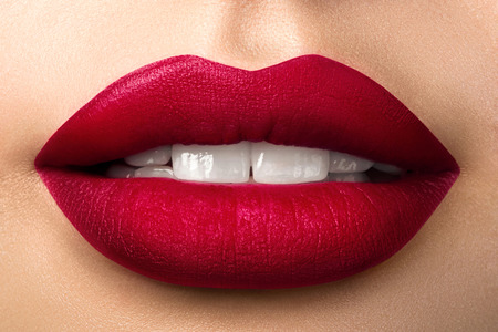 Photo for Close up view of beautiful woman lips with red matt lipstick. Open mouth with white teeth. Cosmetology, drugstore or fashion makeup concept. Beauty studio shot. Passionate kiss - Royalty Free Image