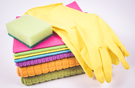 Foto de Cleaning stuff - housekeeping concept. Cleaning supplies isolated on white background. - Imagen libre de derechos