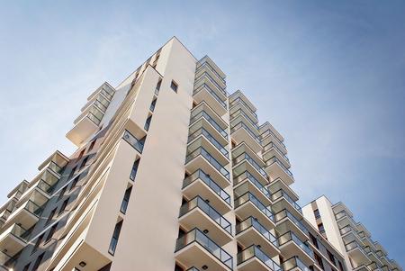 Foto de Modern, Luxury Apartment Building against blue sky - Imagen libre de derechos
