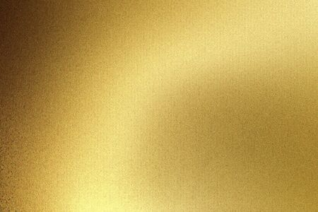Photo for Light shining on gold wave metal plate in dark room, abstract texture background - Royalty Free Image