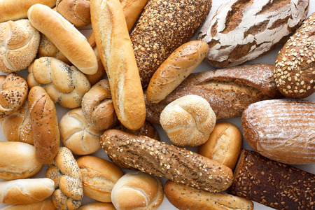 Foto de Many mixed breads and rolls shot from above. - Imagen libre de derechos