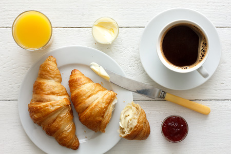 Photo for Coffee orange juice and croissant breakfast. From above. - Royalty Free Image