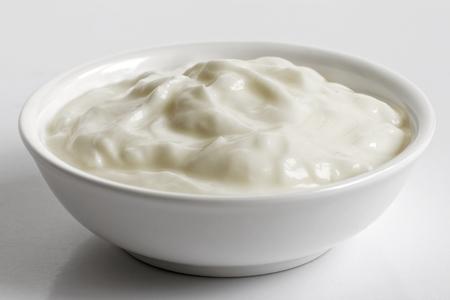Photo for White ceramic bowl of skyr yoghurt isolated on grey background. - Royalty Free Image