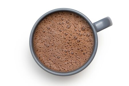 Foto de Hot chocolate in a blue-grey ceramic mug isolated on white from above. - Imagen libre de derechos