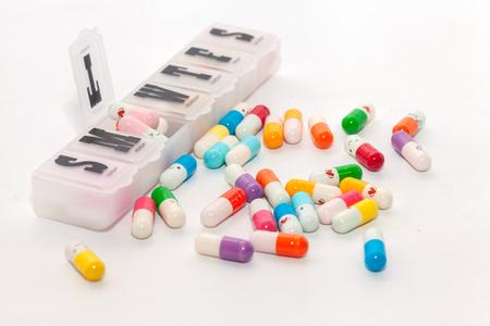 Photo pour colorful pill in the box on white background - image libre de droit