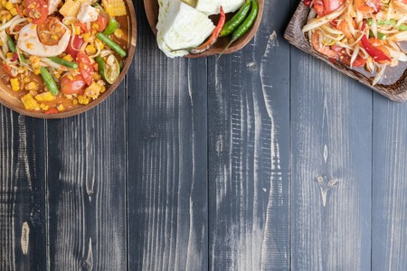 Photo for corn and papaya salad on wooden plate Thai style - Royalty Free Image