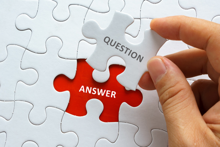 Photo for Hand holding piece of blank jigsaw puzzle with word QUESTION ANSWER. - Royalty Free Image