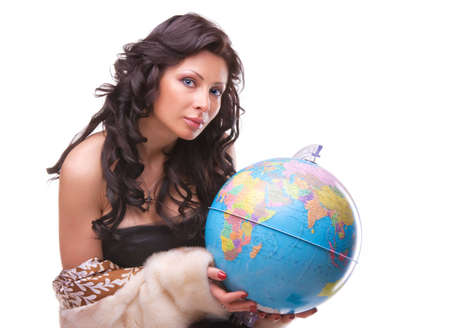 Beautiful woman with a globe isolated over a white background
