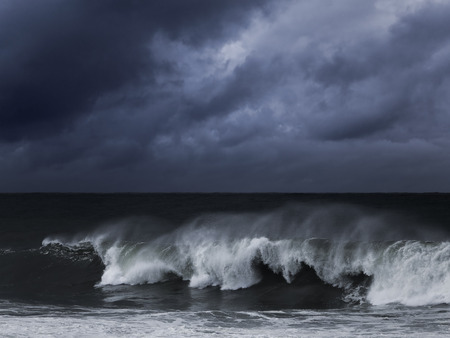 Foto de Big wave against dark dramatic enhanced sky. Toned blue. - Imagen libre de derechos