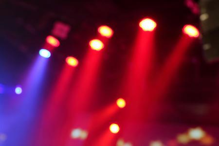 Foto de Blurred photo of stage lights in live concert hall. - Imagen libre de derechos