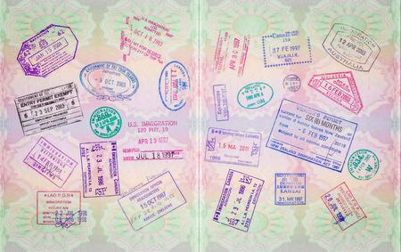 Foto de Retro Vintage Stamps In A European Passport From Multiple Locations - Imagen libre de derechos