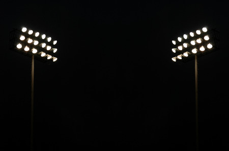 Photo for Twin Stadium Lights At A Sports Stadium At Night With Copy Space - Royalty Free Image
