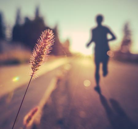 Foto de Retro Vintage Soft Healthy Fitness Runner At Sunset - Imagen libre de derechos