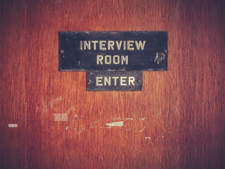 Foto de Retro Filtered Image Of A Grungy Interview Room Door - Imagen libre de derechos