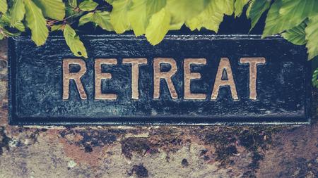 Foto de Retro Styled Image Of A Hidden Sign For A Spiritual Retreat - Imagen libre de derechos