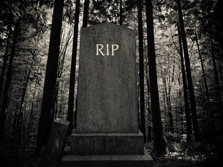 Photo for Spooky RIP Gravestone In A Dark Forest Setting - Royalty Free Image