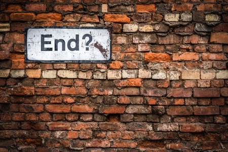 Photo for Uncertainty Concept Image Of A Grungy Sign Saying End? On An Old Red Brick Wall - Royalty Free Image