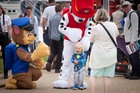 Photo for NORFOLK, UK - AUGUST 19th, 2017: Truckfest Norwich is a transport festival. Mascots Paw Patrol pleasing the young crowd - Royalty Free Image