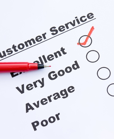 Customer service survey form and pen tick in box